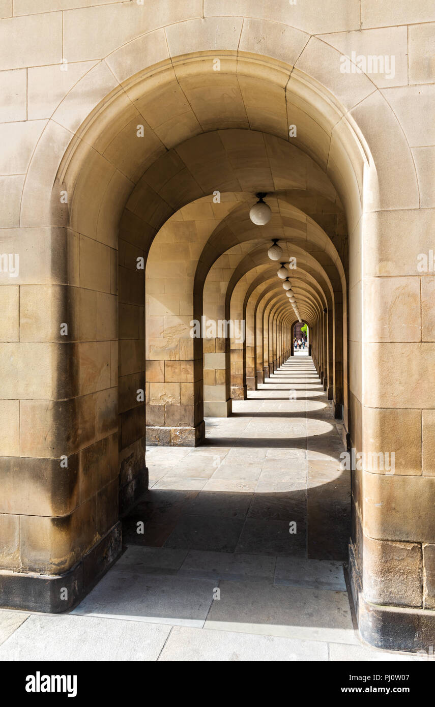 Looking through the arches of Manchester Central Library in St Peter's Square Stock Photo