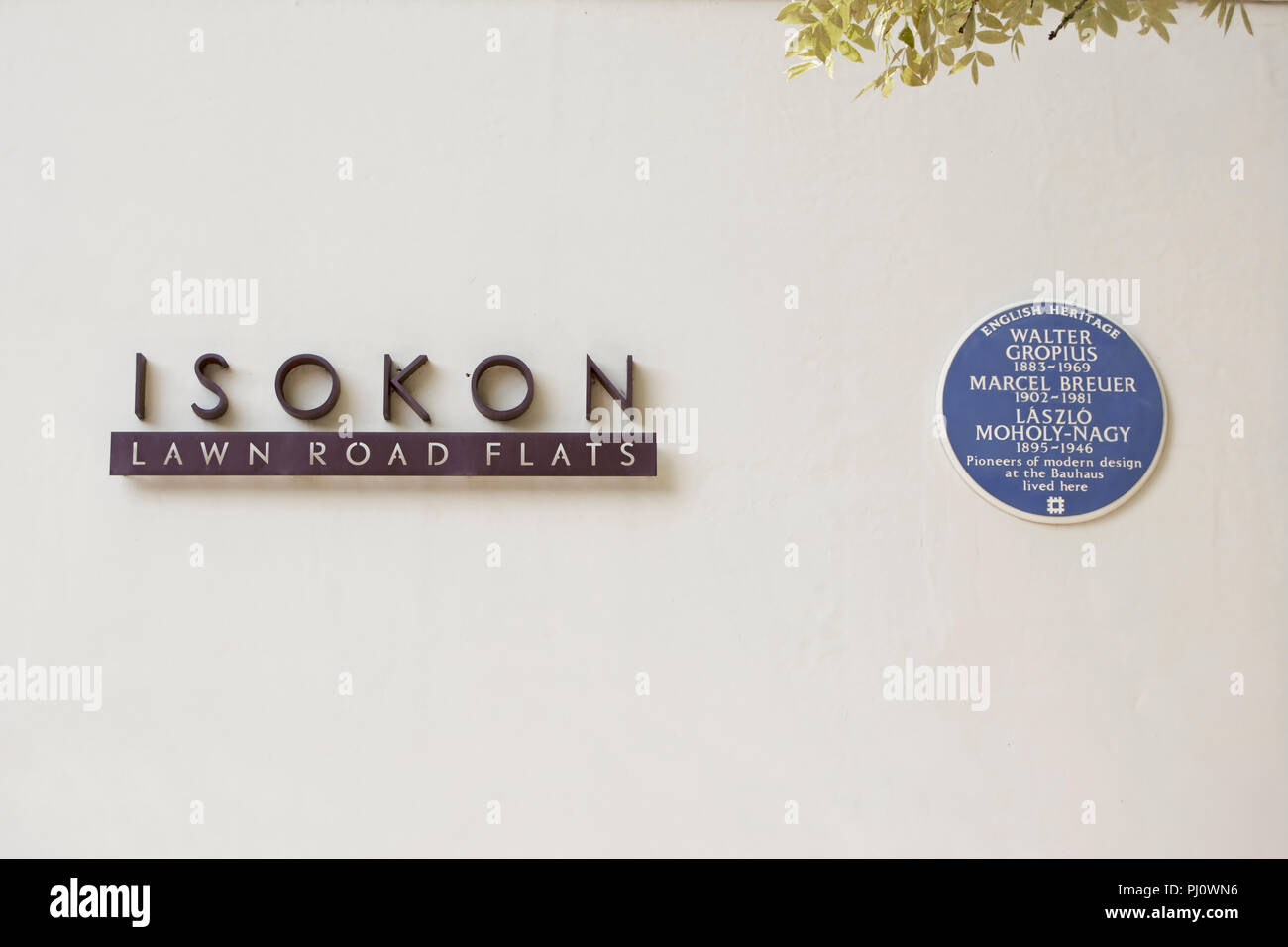 exterior with name sign of isokon lawn road flats, with blue plaque naming residents walter gropius, marcel breuer and laszlo moholy-nagy - Stock Image