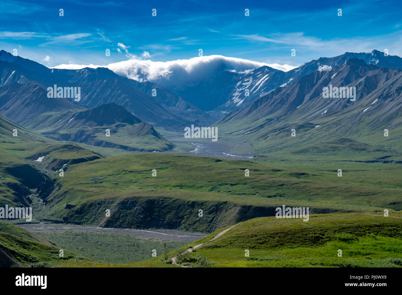 View of the Alaska Range mountains from Eielson Visitors Center in Denali National Park as storm clouds roll in over the mountain peaks Stock Photo