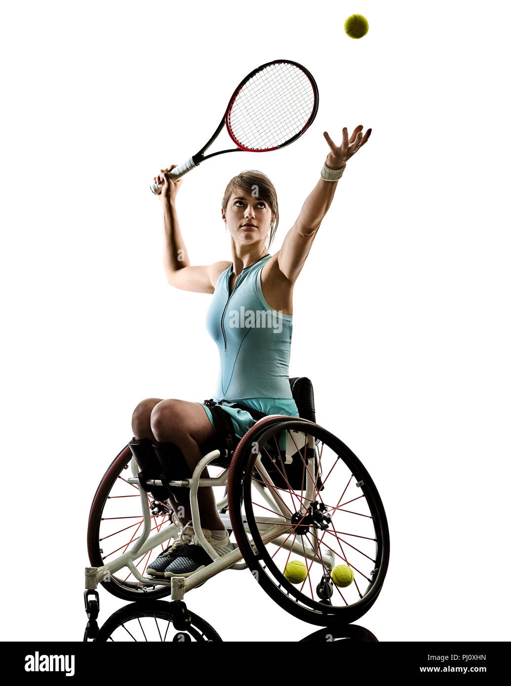 one caucasian young handicapped tennis player woman in wheelchair sport  tudio in silhouette isolated on white background - Stock Image