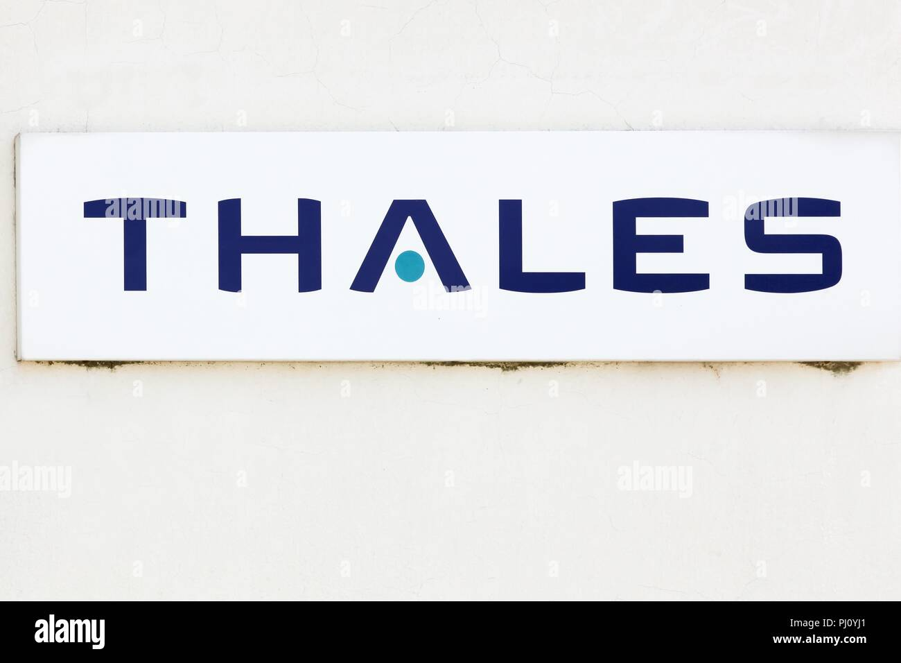 Valence, France - July 1, 2018: Thales logo on a wall. Thales is a French multinational company and an electronics group specializing in aerospace - Stock Image