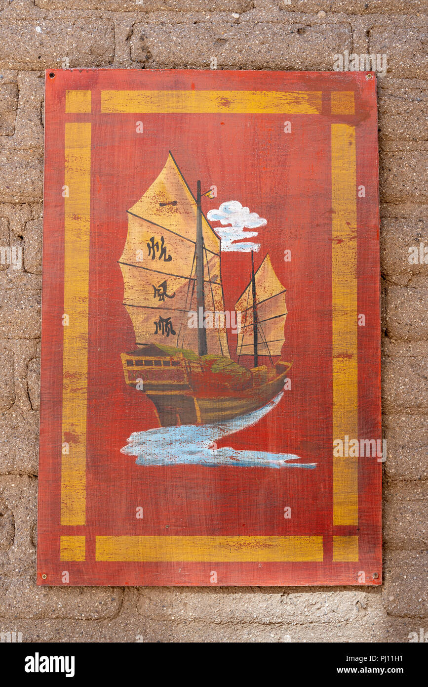Wooden sign with old Chinese sailing boat. - Stock Image