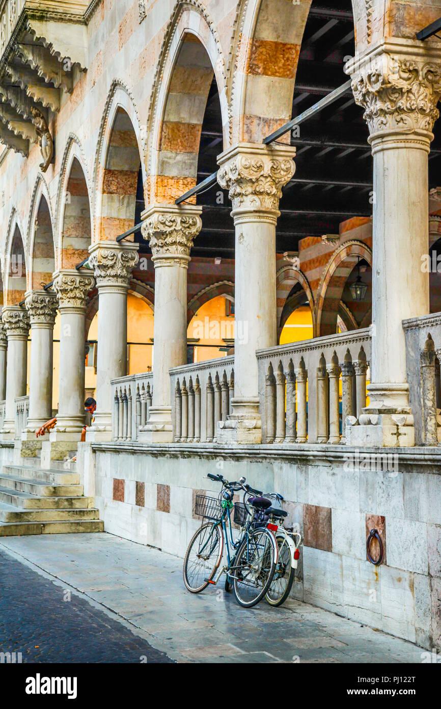 Bicycles outside the Loggia del Lionello in the Piazza della Liberta in Udine, Italy - Stock Image