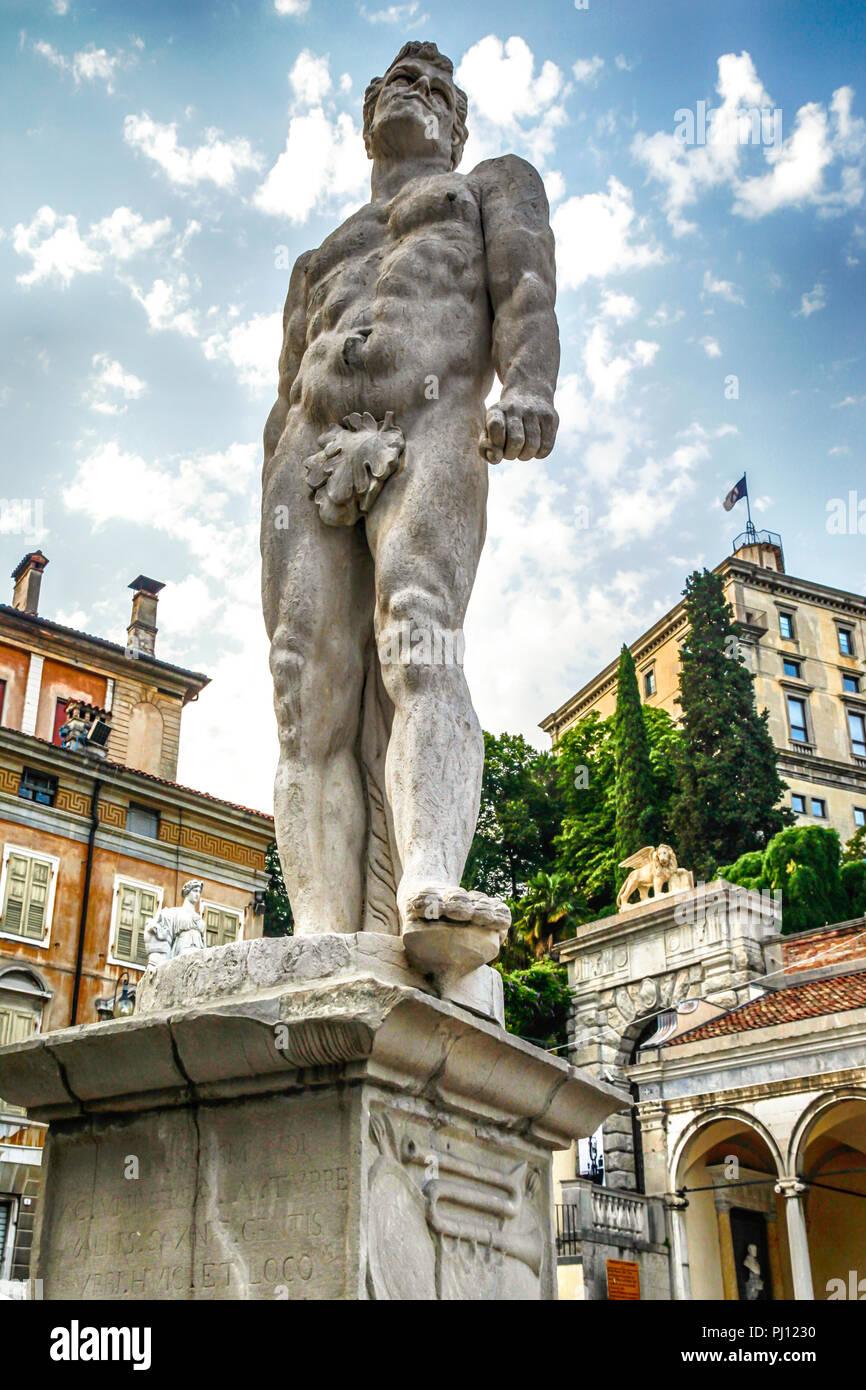 Statue of the Roman god, Hercules in the Piazza della Liberta in Udine, Italy - Stock Image
