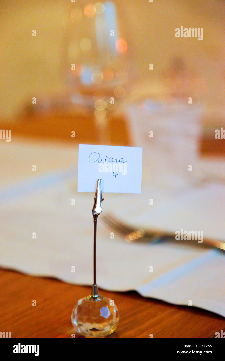 Reservation card at a table at Trattoria Antica Maddalena restaurant on Via Pelliccerie in Udine, Italy - Stock Image