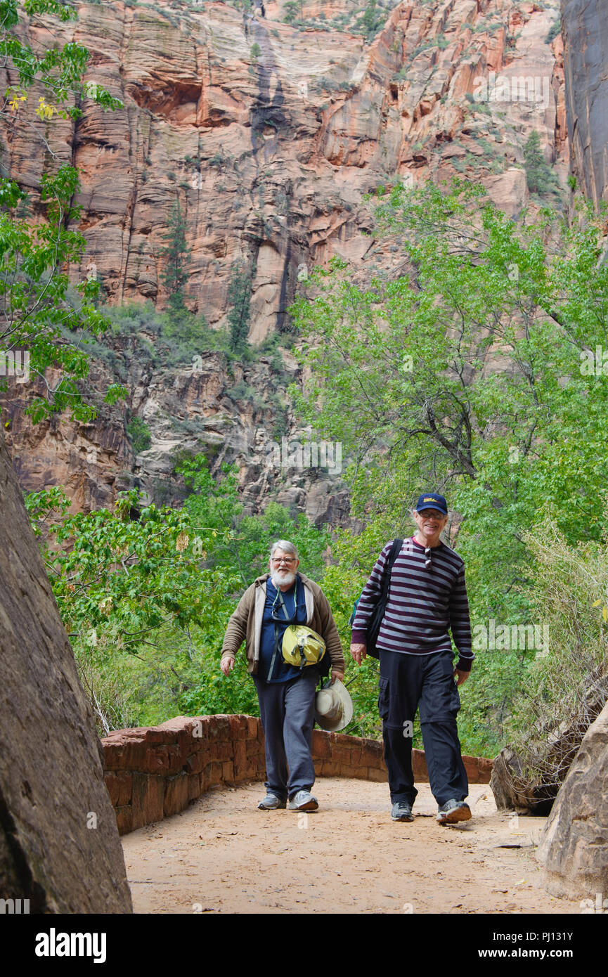 Two older men hiking on a trail in Zion National Park, Utah. USA. - Stock Image