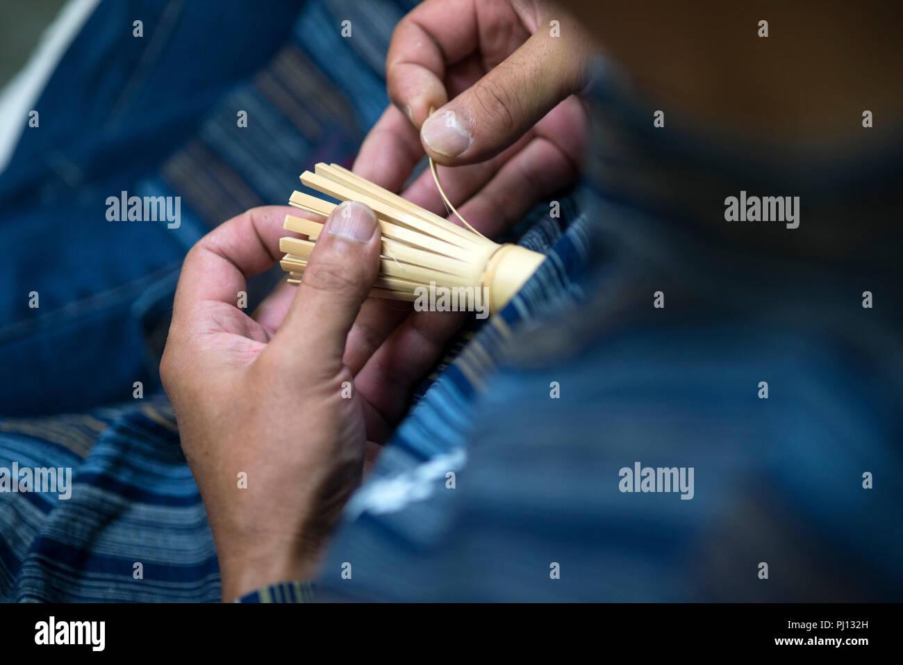 Chasen craftsman Kyosuke Kubo bends the tines of a Takayama chasen tea whisk inside his family's Chikusendo workshop in Takayama district of  Ikoma Ci - Stock Image