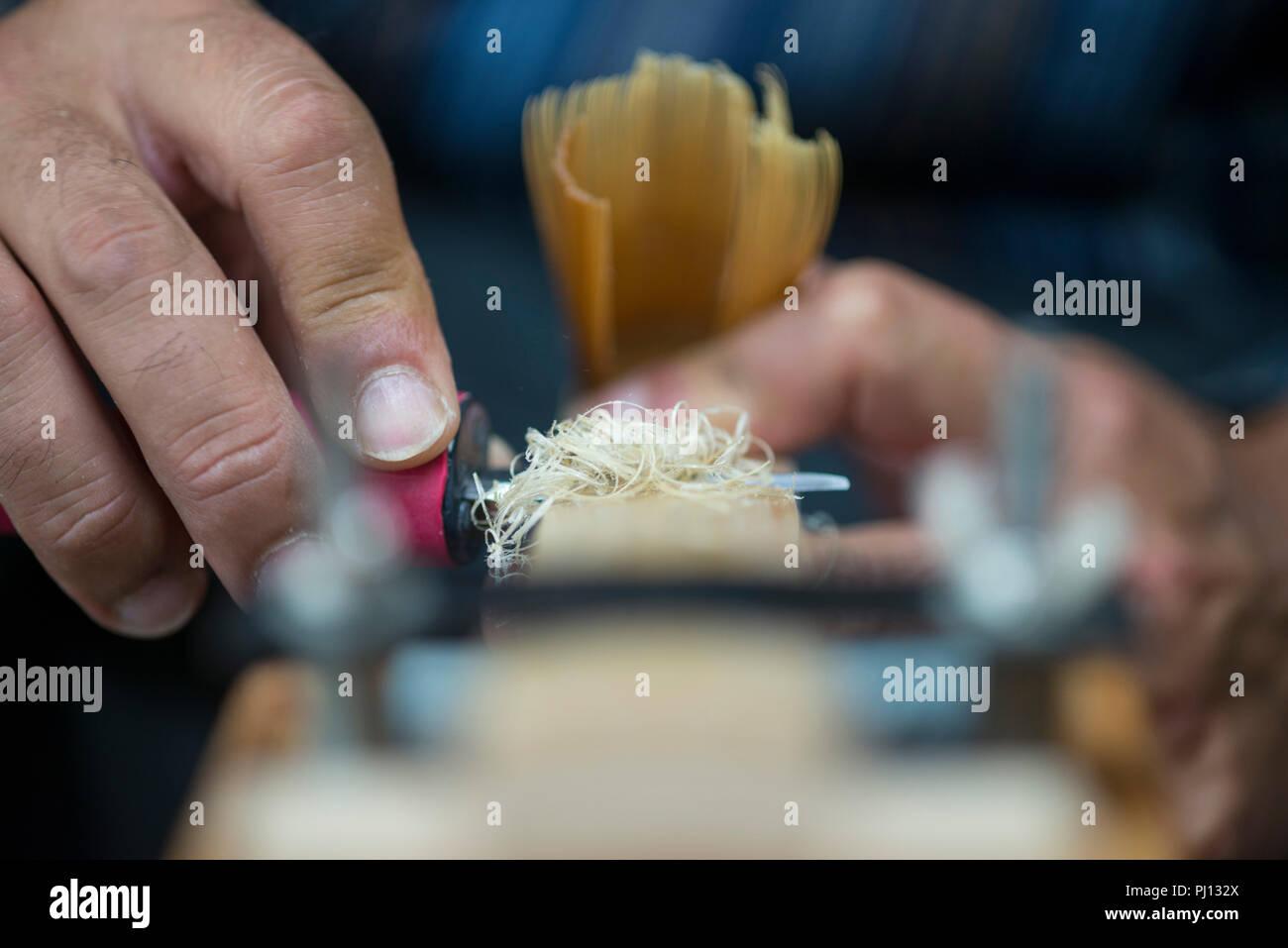 Chasen craftsman Kyosuke Kubo shaves the tines of a Takayama chasen tea whisk inside his family's Chikusendo workshop in Takayama district of  Ikoma C - Stock Image