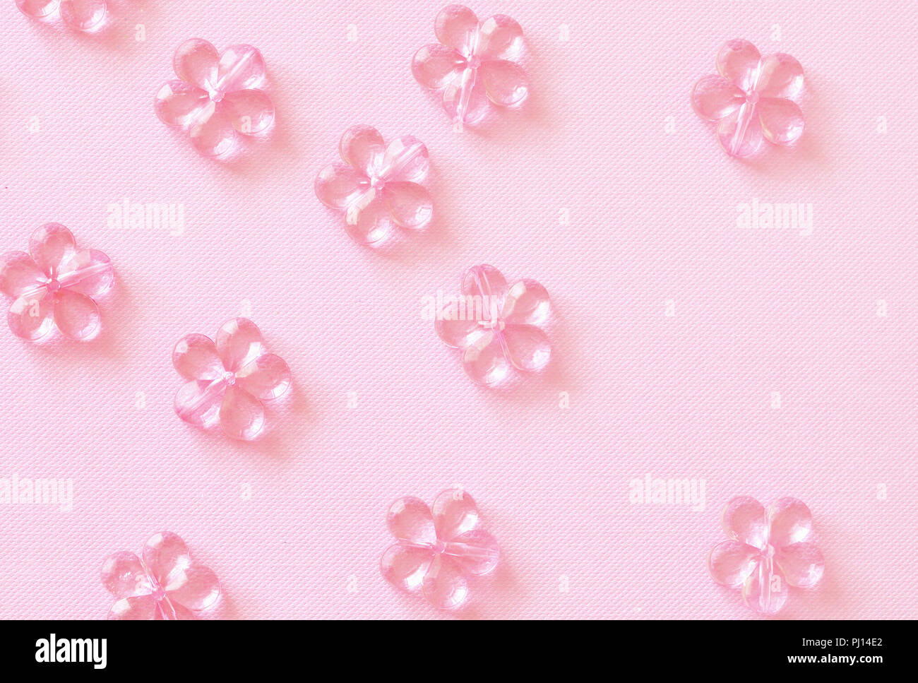 Pink Craft Plastic Flowers On Paper Background Top View Flat Lay