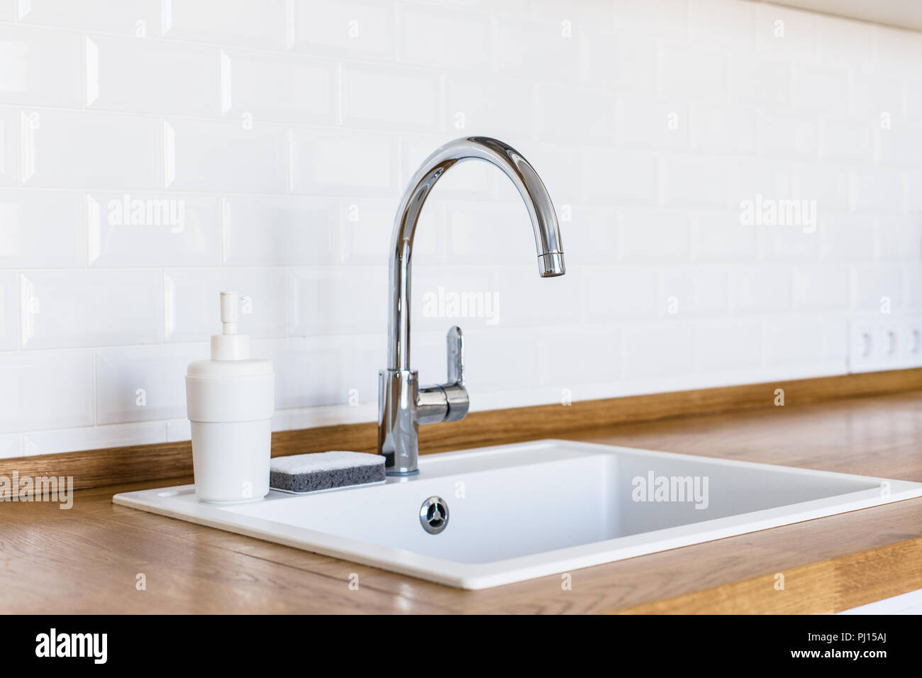 Clean Kitchen White Sink Soap Dispenser And Sponge For Washing