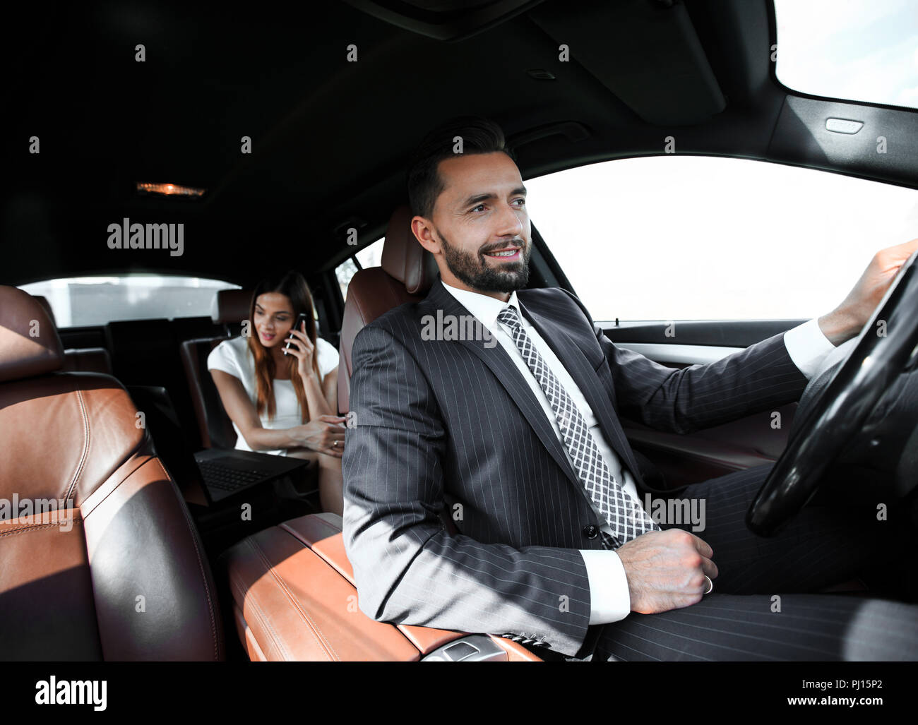 Attractive elegant serious man drives good car Stock Photo