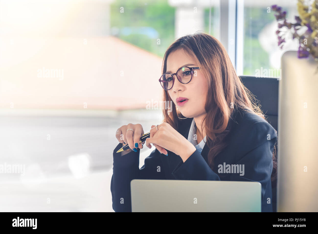 Businesswoman sitting in office desk ,Concept for Committee hiring manager to interview finalists - Stock Image