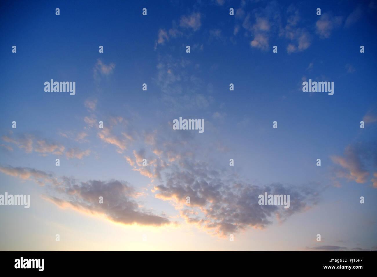 Alto cumulus cloud patterns at sunset. - Stock Image
