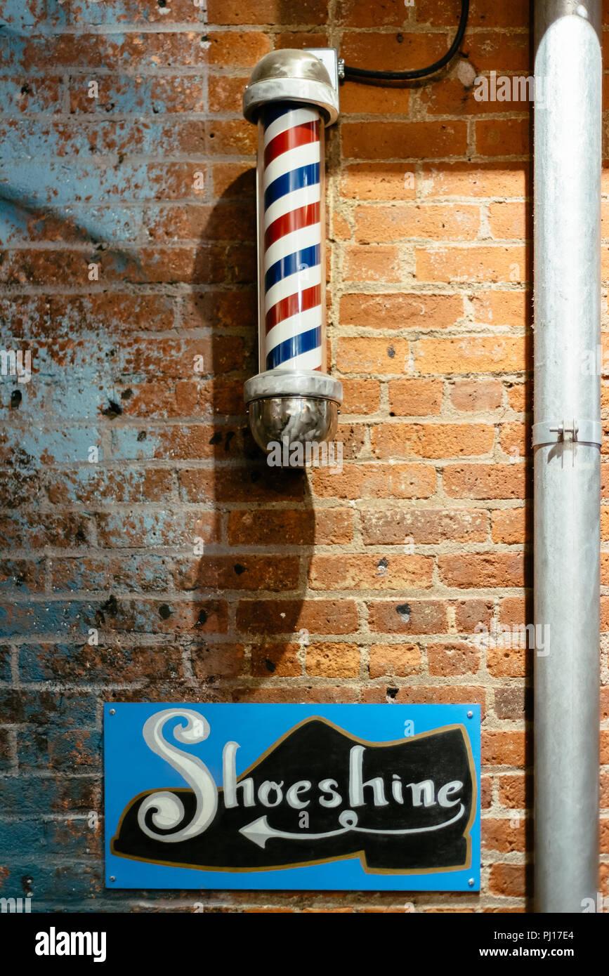 New York City, USA - June 22, 2018: Shoeshine and barbershop signs