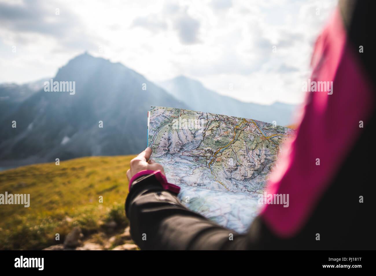 Girl navigating in Austrian Alps - Stock Image