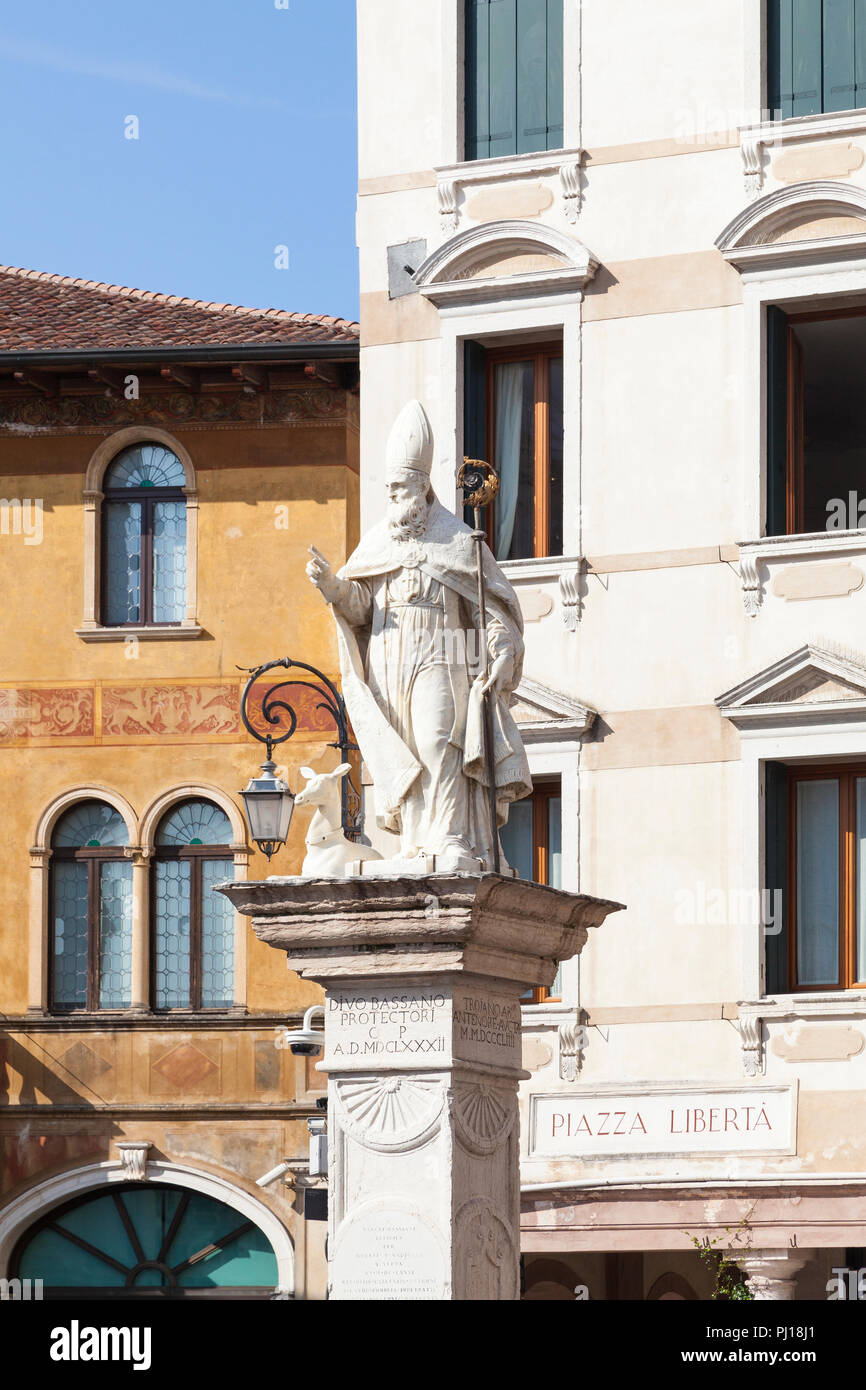 Statue of San Bassiano in Piazza Liberta, Bassano del Grappa, Vicenza, Italy. St Bassiano is the patron saint and protector of the town. Early morning - Stock Image