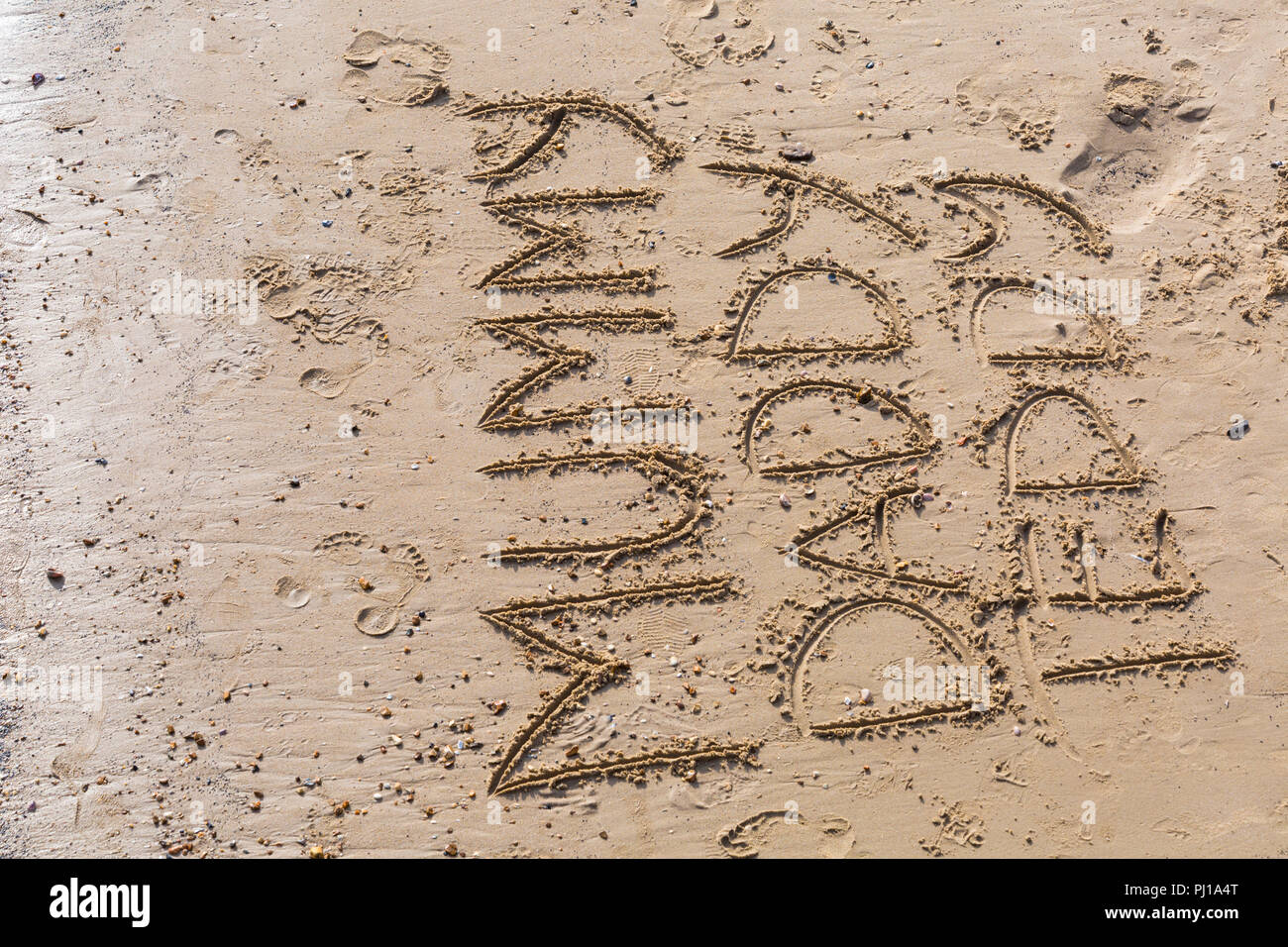Mummy Daddy Teddy written in the sand on Bournemouth beach at Bournemouth, Dorset UK in September - Stock Image