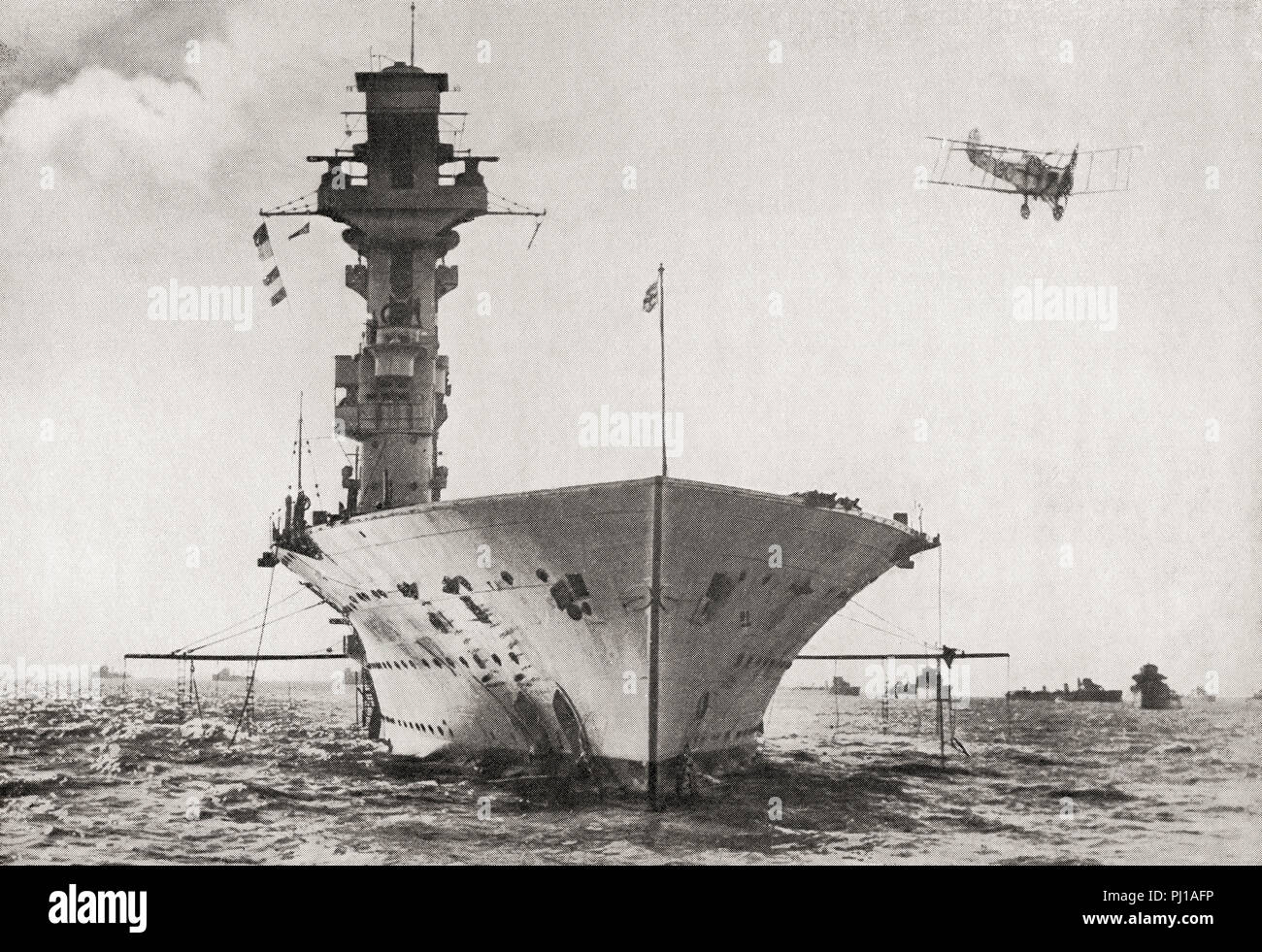 HMS Hermes, a British aircraft carrier built for the Royal Navy, the world's first ship to be designed as an aircraft carrier, she was sunk by Japanese aircraft, 9 April 1942.  From The Book of Ships, published c.1920. - Stock Image