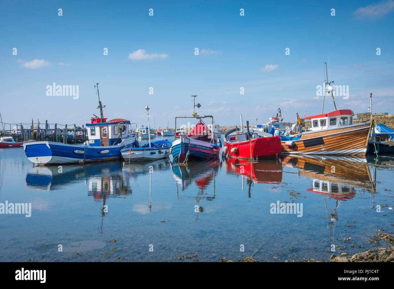 Small fishing boats in Paddy's Hole on South Gare which was named for the many Irishmen who helped build the South Gare. - Stock Image