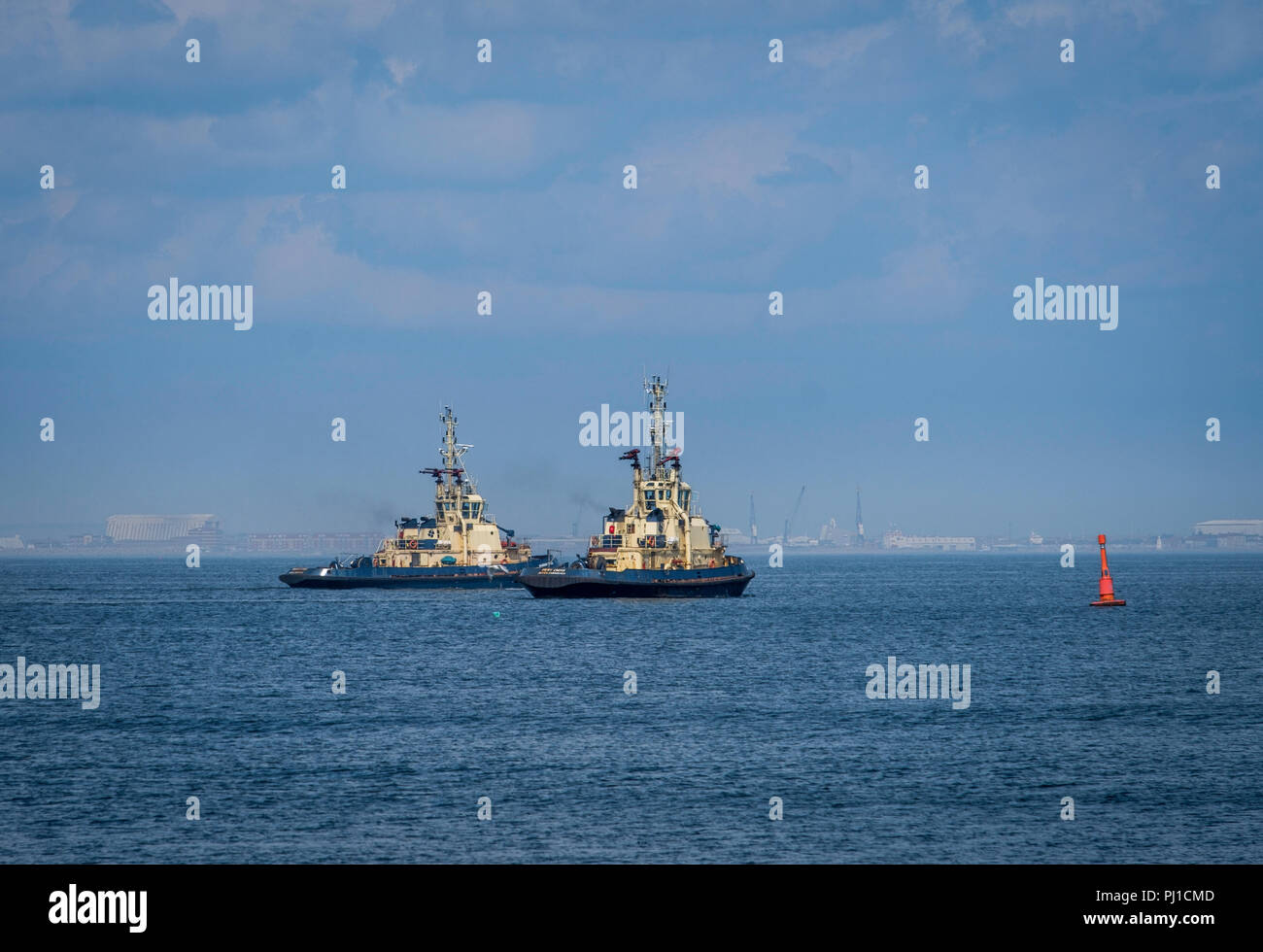 Tugs set out of the Tees to bring in a ship. - Stock Image