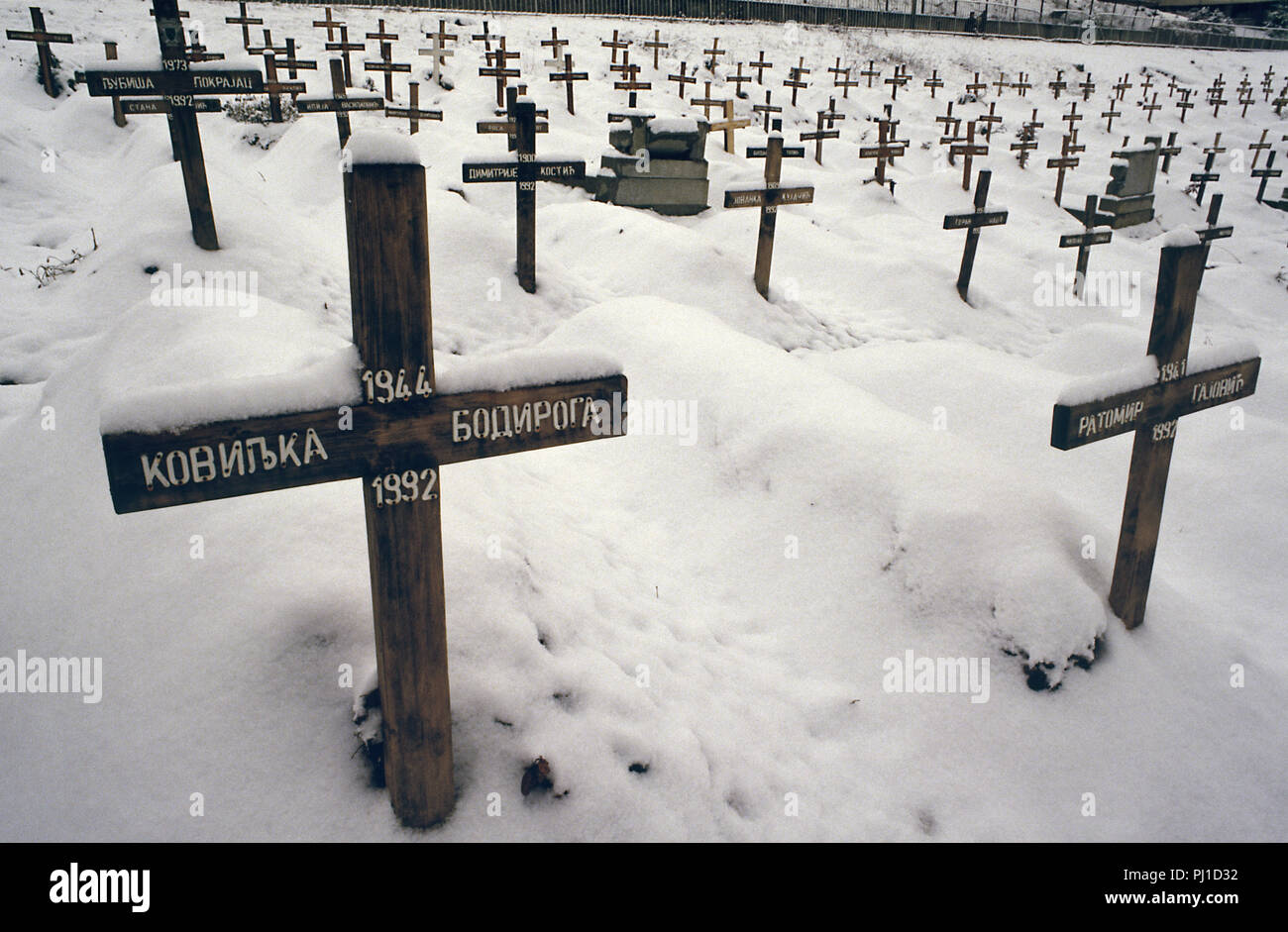 4th March 1993 A view of part of the Lion Cemetery in Sarajevo, just below the Kosevo Hospital: dozens of wooden crosses in the snow are all dated 1992. They bear the names of Serb victims of the Siege of Sarajevo. - Stock Image