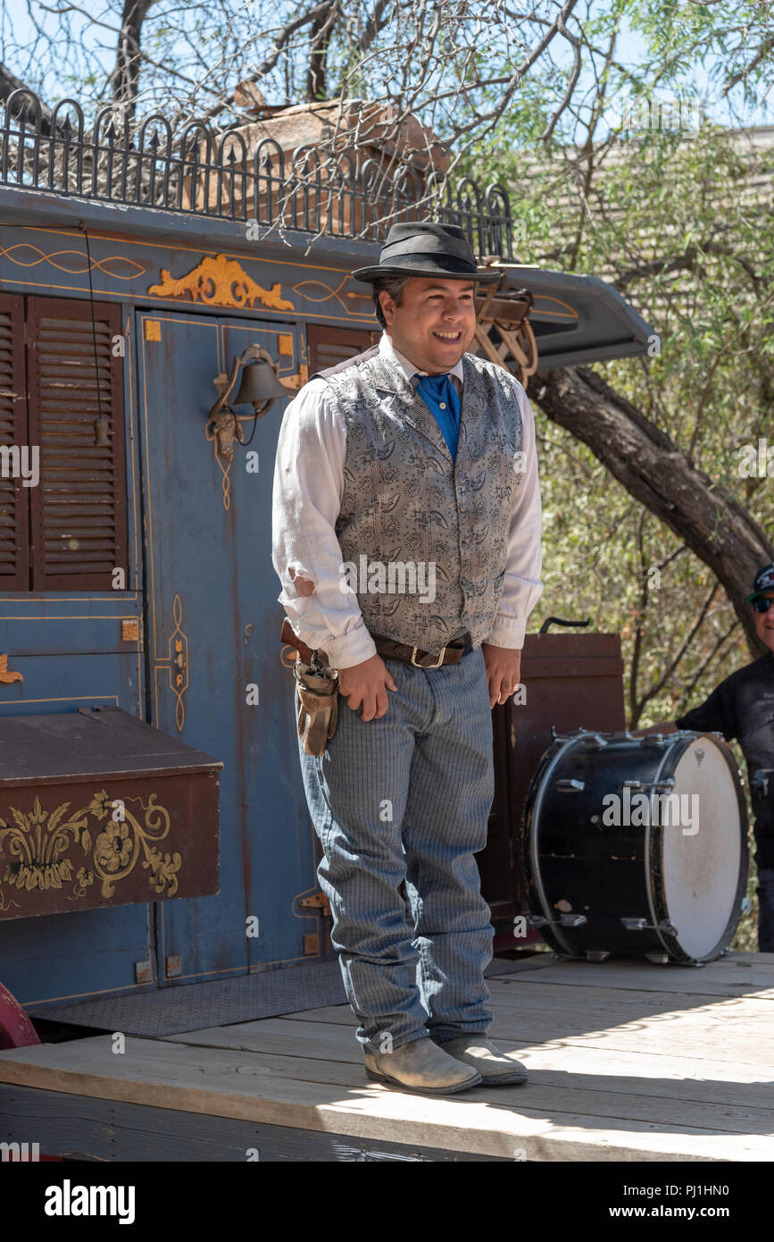 Western style actor standing in front of medicine wagon. - Stock Image