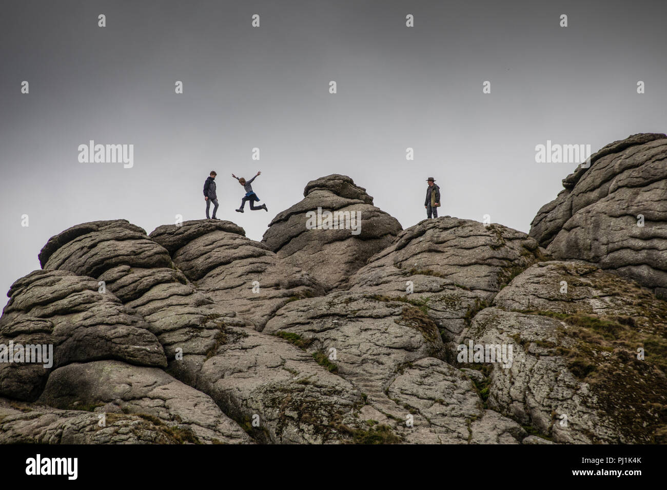 Rock hopping on Haytor on Dartmoor, UK - Stock Image
