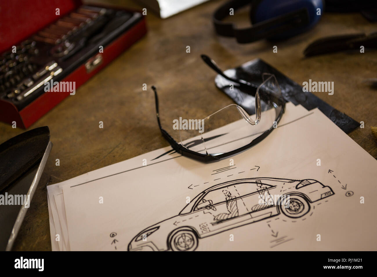 Protective eyewear with chart on a table - Stock Image