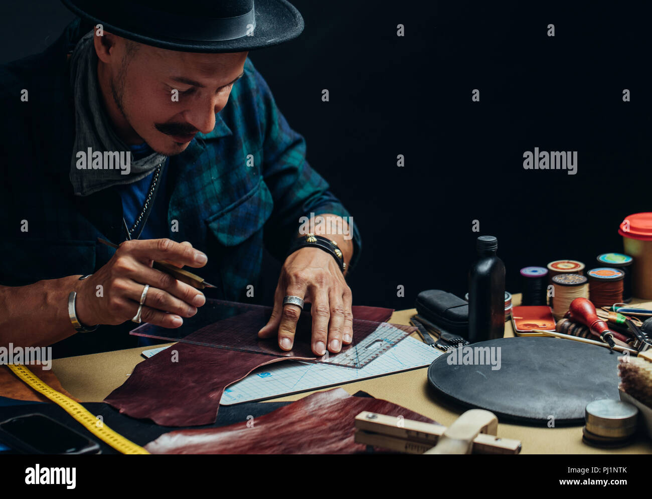 Working process of making shoes in workshop. - Stock Image