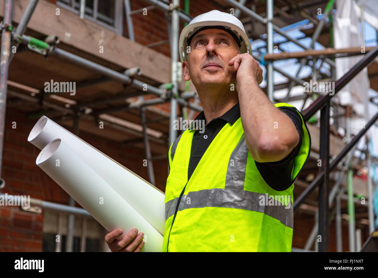 Male builder foreman, worker or architect on construction
