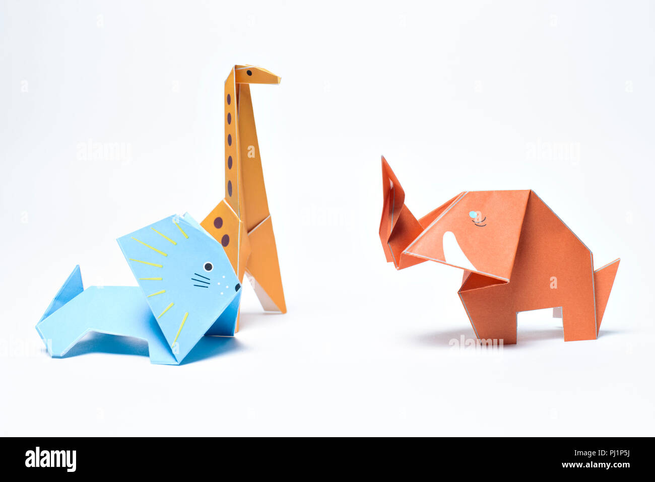 Paper Origami Giraffe Lion And Elephant On White Background Stock