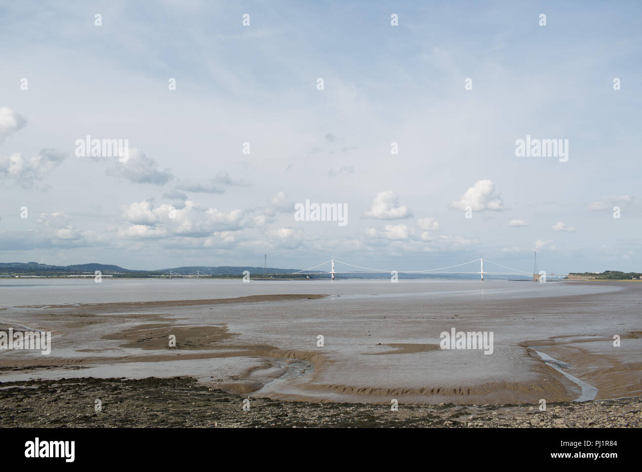 View of the Severn Bridge and the River Severn at low tide from the English side. Suspension Bridge. Tolls due to end in 2018. M48 motorway - Stock Image