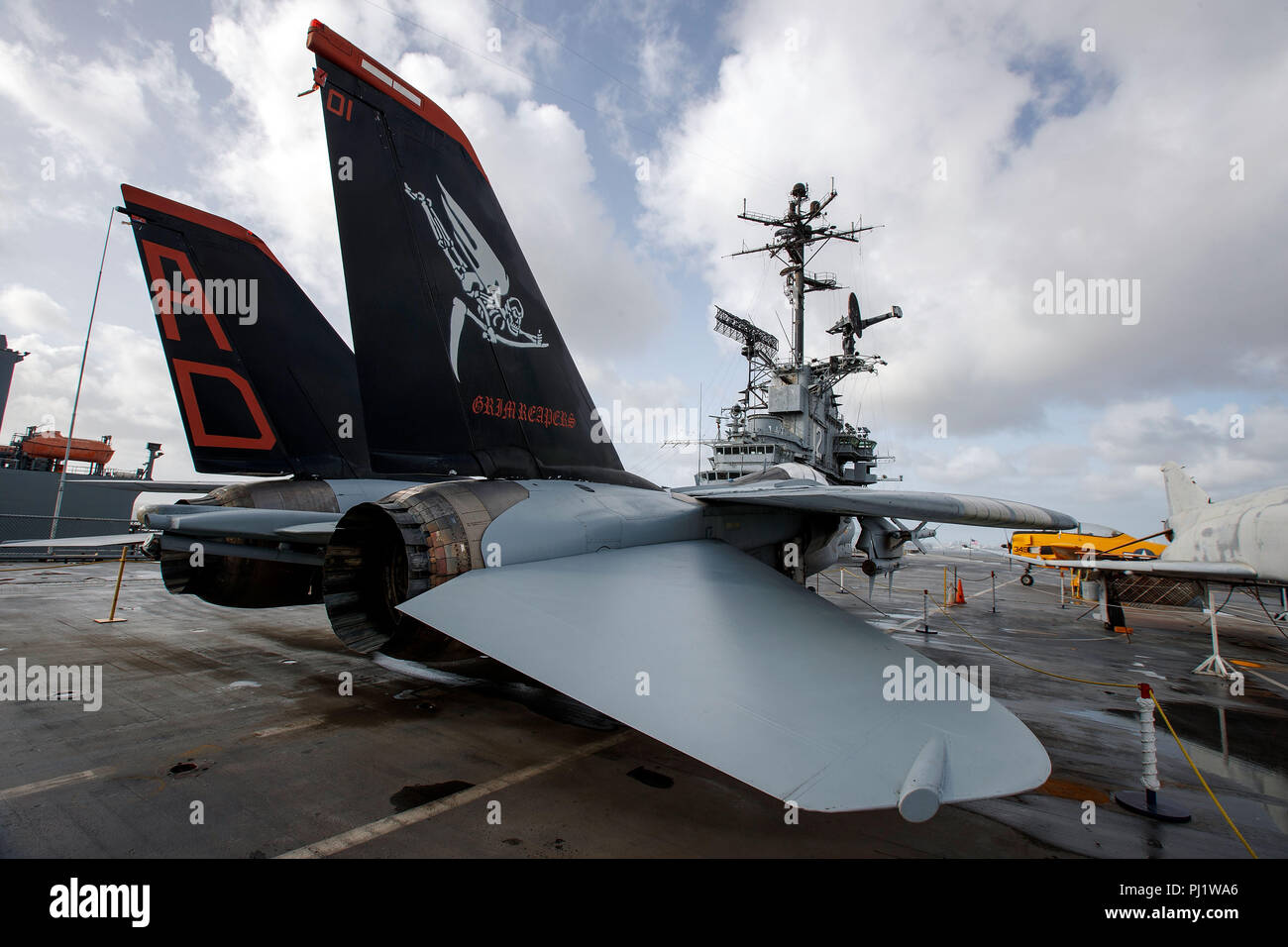 Grim Reapers tail art on Grumman F-14A Tomcat on the deck of the USS Hornet Museum, Alameda, California, United States of America - Stock Image