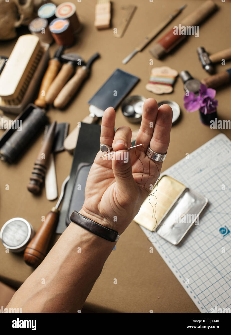 Working process of producing hand made leather wallet in the leather workshop. - Stock Image