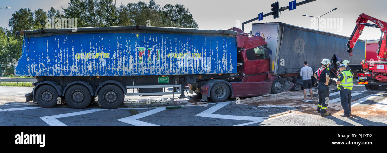 The collision of two trucks in Latvia, on the A8 road, occurred on August 23, 2018.The truck driver Iveco saw people on the pedestrian crossing and br - Stock Image