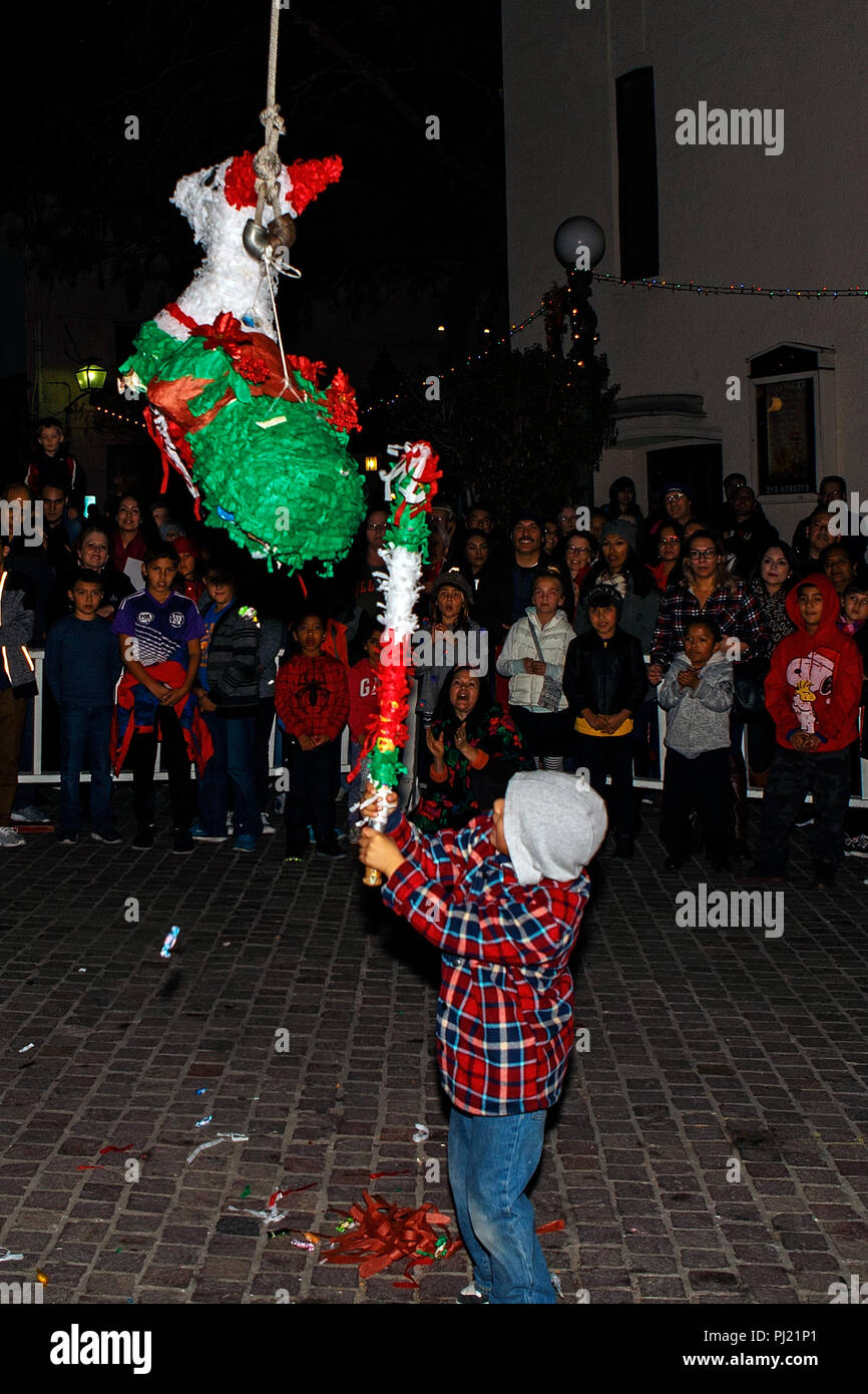 Christmas Celebration In America.Children Hit A Pinata During The Los Posadas Christmas