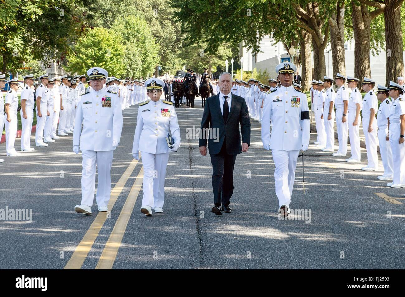 U.S Secretary of Defense James Mattis, second right, leads a procession of the flag draped casket of Sen. John McCain following on a horse-drawn caisson to the United States Naval Academy Cemetery for his burial service September 2, 2018 in Annapolis, Maryland. John S. McCain, III graduated from the United States Naval Academy in 1958. He was a pilot in the United States Navy, a prisoner of war in Vietnam, a Congressmen and Senator and twice presidential candidate. He received numerous awards, including the Silver Star, Legion of Merit, Purple Heart, and Distinguished Flying Cross. - Stock Image