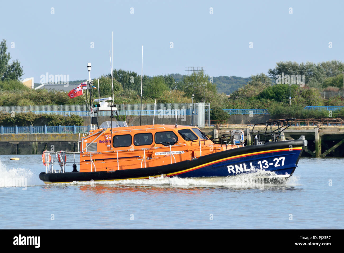 """London, UK, 3rd September 2018  – The newest RNLI Shannon-class Lifeboat 13-27, called """"Joanna and Henry Williams"""", seen heading up the River Thames at speed as it heads to London. Credit: A Christy/Alamy Live News. Stock Photo"""