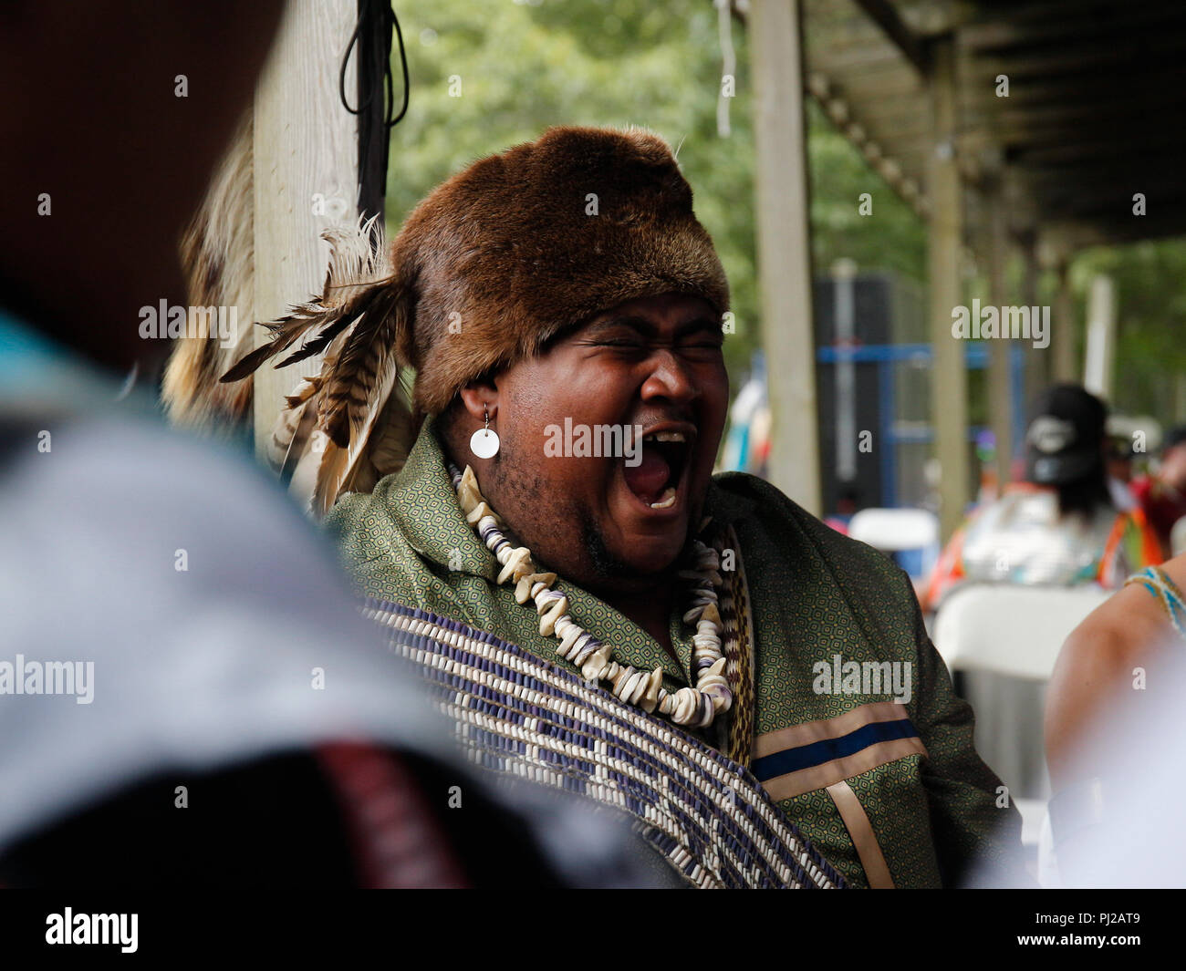 Southhampton, United States of America. 03rd, Sep 2018. A Native American singing with the group before the presentation to the ceremony 72nd annual Shinnecock Indian Powwow over the Labour Day weekend in Southampton Long Island New York in Southhampton, United States of America, 03 September 2018. (PHOTO) Alejandro Sala/Alamy News Stock Photo