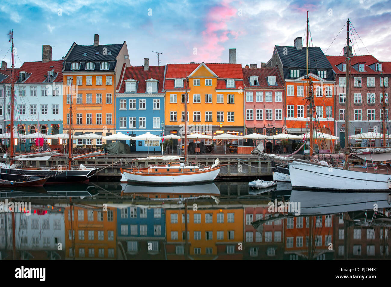 Nyhavn at sunrise in Copenhagen, Denmark. - Stock Image