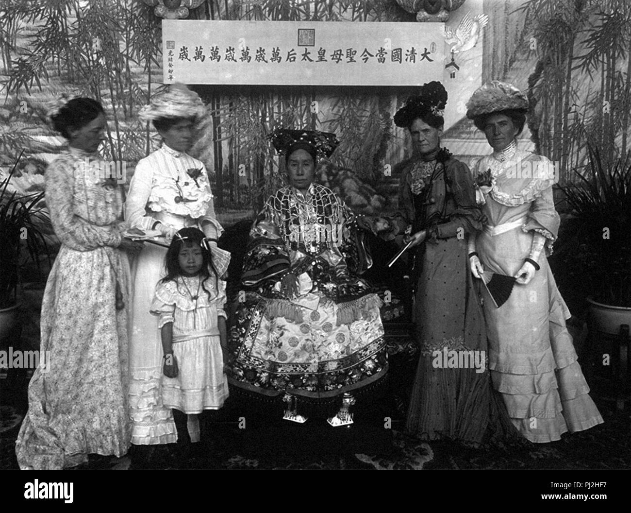 Empress Dowager Cixi and women of the American legation. Holding her hand is Sarah Conger, the wife of U.S. Ambassador Edwin H. Conger. - Stock Image