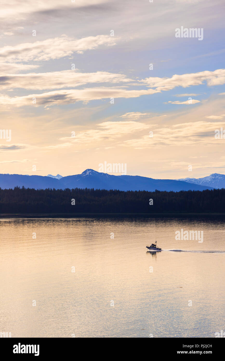 Sunrise in Icy Strait at the entrance to Glacier Bay, Alaska, USA - Viewed from a cruise ship sailing the Inside Passage - Stock Image