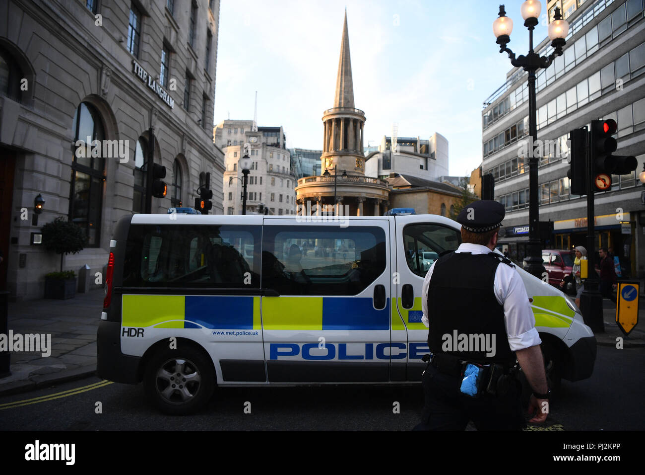 A police van outside of BBC Broadcasting House, on Portland Place, London, after reports of a specious vehicle outside the building. Stock Photo