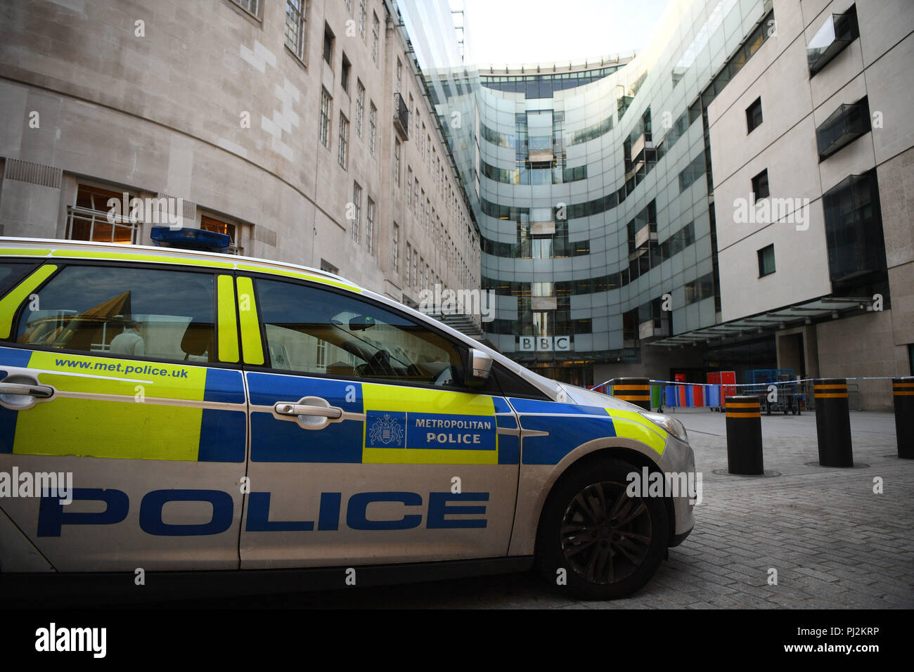 A police car outside of BBC Broadcasting House, on Portland Place, London, after reports of a specious vehicle outside the building. Stock Photo