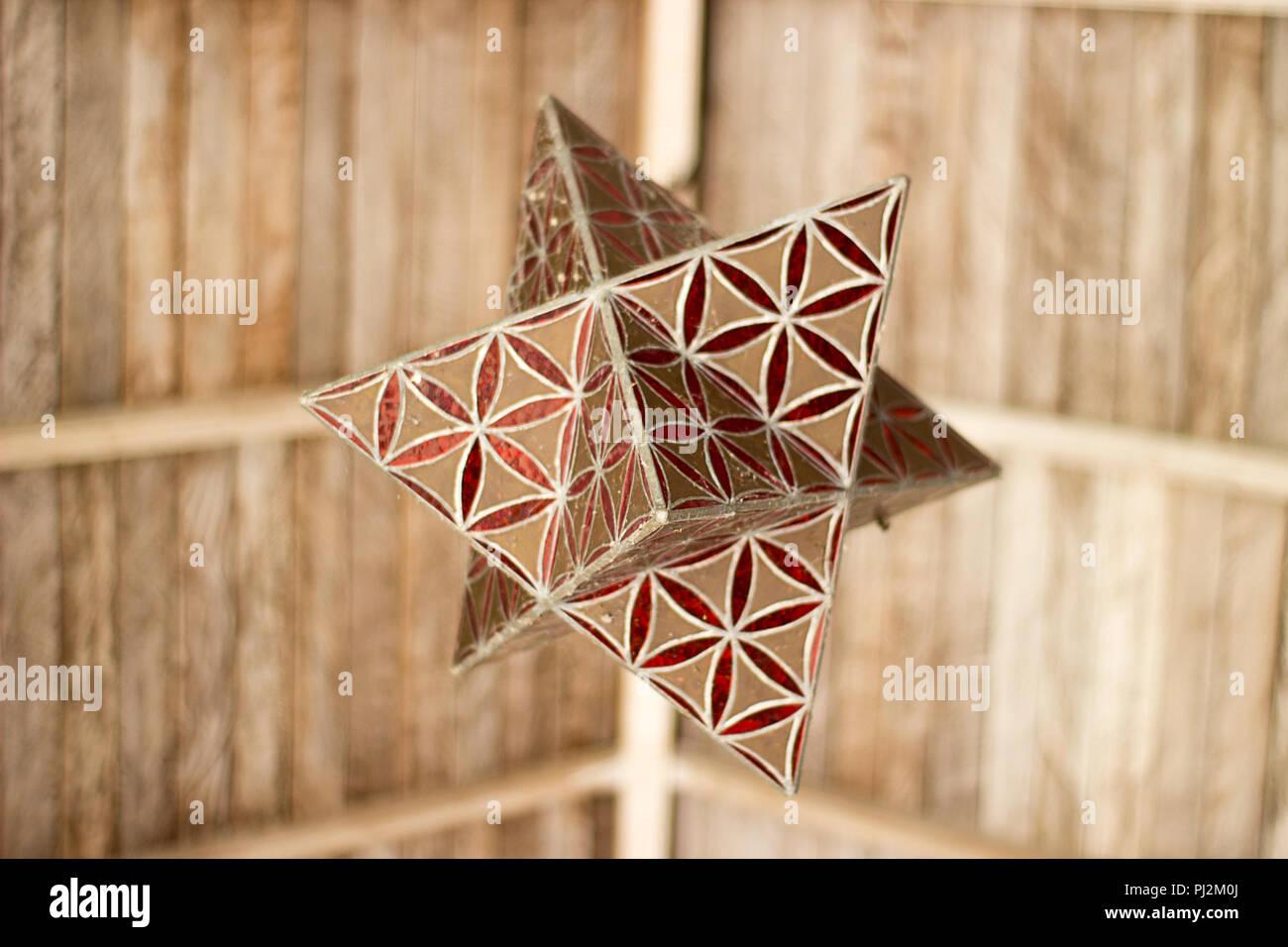Original chandelier under the wooden roof - Stock Image