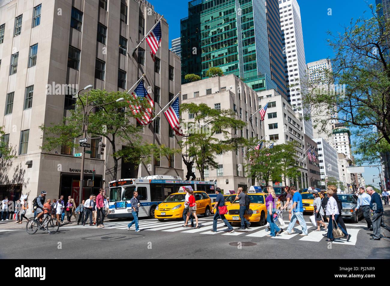 Busy city street crossing on Fifth Avenue, New York City, America, USA Stock Photo