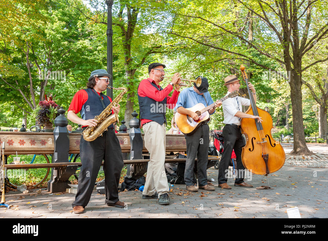 Jazz musicians busking in Central Park, New York City, USA - Stock Image