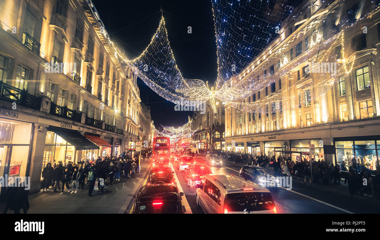London, UK - December 26, 2016: Regent Street angels holiday lights with crowds of shoppers in London, United Kingdom Stock Photo