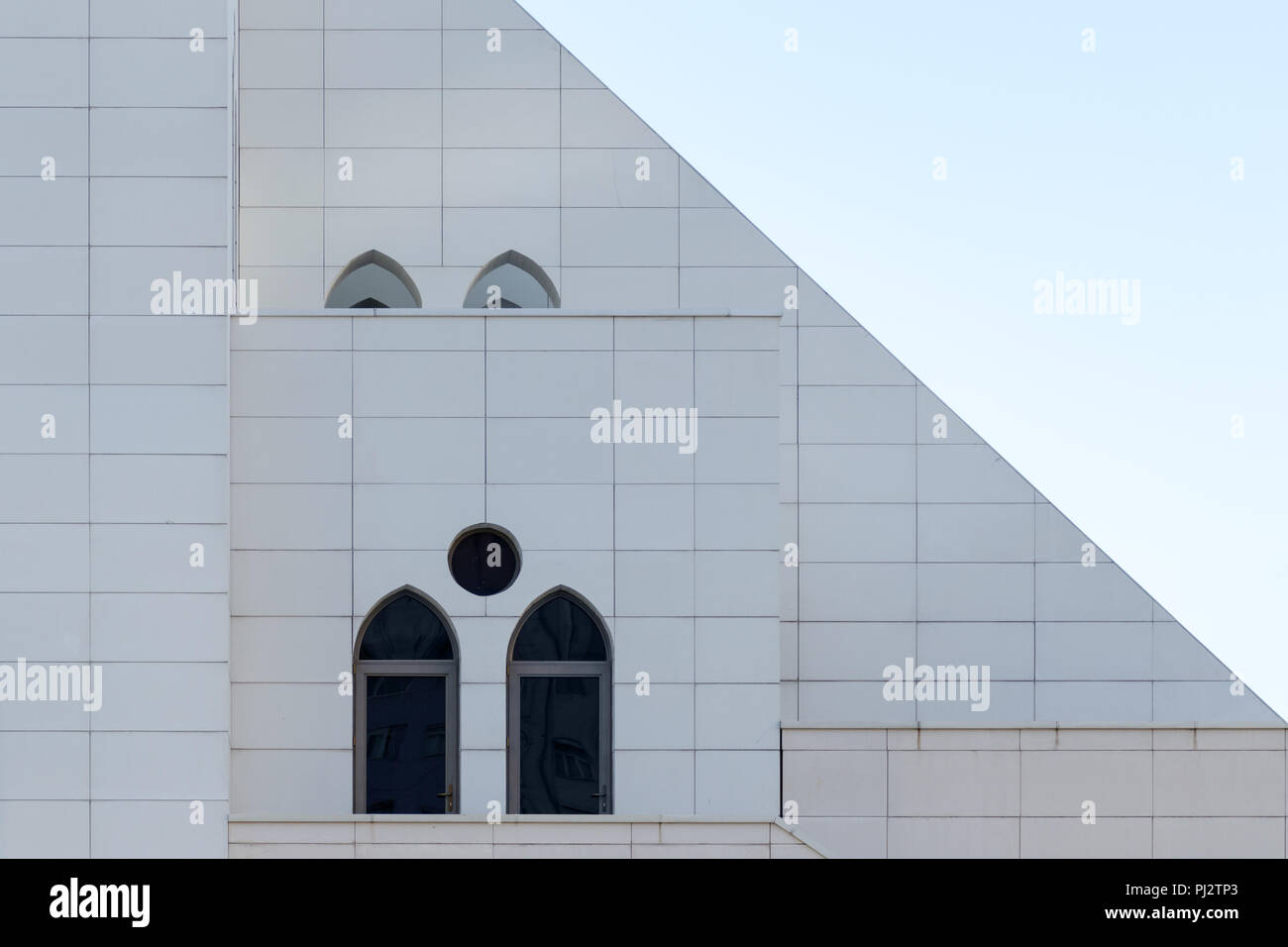 white wall with an arched and round windows detail of building exterior urban geometry copy space abstract minimal style architecture background PJ2TP3