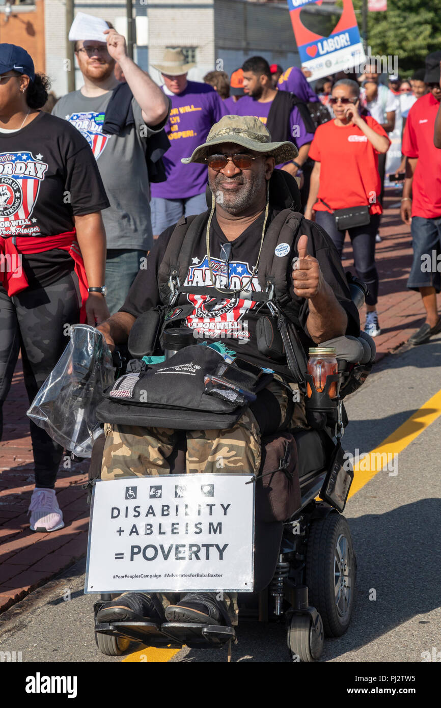 Detroit, Michigan - 3 September 2018 - A disabled man in a wheelchair joins Detroit's Labor Day parade. - Stock Image
